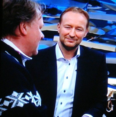 Former Olympic skier and World Champion Kjetil André Aamodt, interviewing the head of the Norwegian men's curling team, Pål Trulsen, for state broadcaster NRK's nightly show during the Winter Olympics in Sochi. PHOTO: NRK screen grab/newsinenglish.no