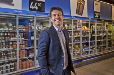 Ole Robert Reitan, one of the heirs to the REMA 1000 grocery store chain, kept smiling through the storm on Monday, as he accused rivals of breaking the law. He also wants to revive the debate over shopping on Sundays, which remains restricted in Norway. PHOTO: REMA 1000