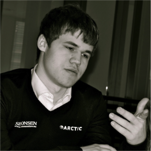 Carlsen sporting the logos of his new sponsors.