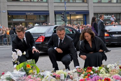 Jens Stoltenberg (center) played a major role in leading Norway through the national trauma of July 22, 2011. He's shown here laying down flowers outside the Oslo Cathedral two days after the attacks, with his wife Ingrid Schulerud and the head of Labour's youth organization AUF at the time, Eskil Pedersen. PHOTO: newsinenglish.no