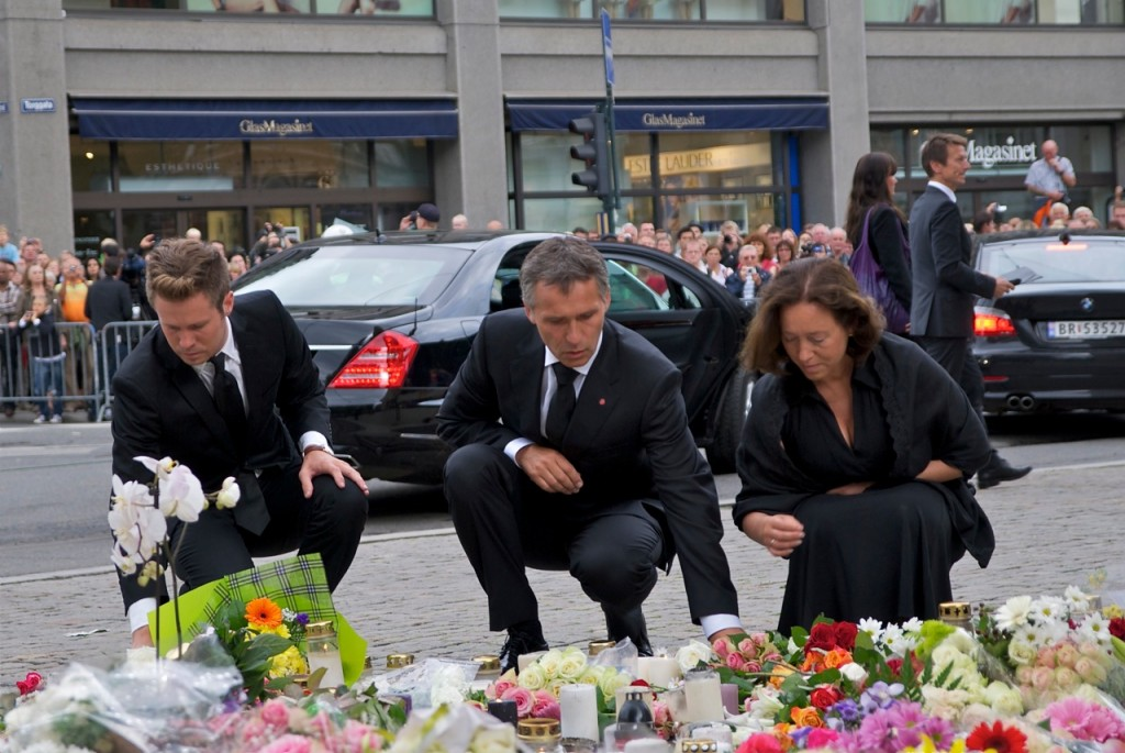 Prime Minister Jens Stoltenberg (center) laying flowers at a victims' memorial with his wife, diplomat Ingrid Schulerud, and Eskil Pedersen, leader of Labour's youth organization AUF who survived a massacre at AUF's summer camp on Friday. PHOTO: Views and News