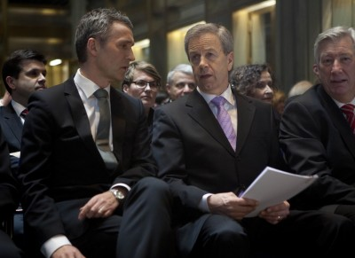 Central bank boss Øystein Olsen (center) sitting in the front row at Thursday's annual gathering of Norway's elite, flanked by Prime Minister Jens Stoltenberg (left) and Finance Minister Sigbjørn Johnsen. PHOTO: Norges Bank / Ståle Andersen