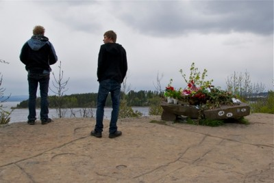 These two young men were among quiet mourners visiting the makeshift memorial over the weekend that's been set up on the mainland across from Utøya. Ten months after the massacre on Utøya, the memorial is still constantly replenished with fresh flowers, candles and notes of condolence. A book in which visitors can write down their own thoughts and messages had been placed under the rock adorned with flowers. PHOTO: Views and News