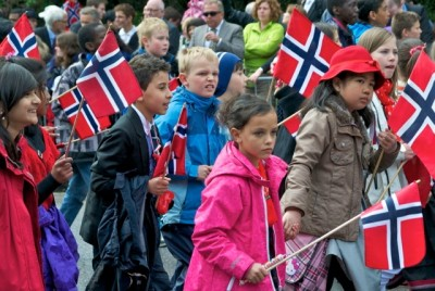 Norwegian children marching in this year's 17th of May parade will be young adults when the population hits 6 million, and likely will contribute towards more growth. PHOTO: Views and News