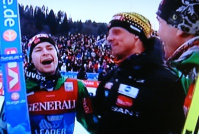 Anders Jacobsen howled with delight after winning the prestigious ski jumping competition on New Year's Day. His coach Alexander Stöckl (center) was nearly speechless, while teammate Anders Bardal was thrilled as well and placed third himself. PHOTO: NRK screen grab/newsinenglish.no