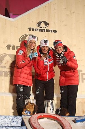 Norwegians took all three spots on the winners' platform after Saturday's 15-kilometer skiathlon: Marit Bjørgen (center) won gold, Therese Johaug won silver and Heidi Weng won bronze. PHOTO: FIS Nordic World Ski Championships/fiemme2013.com