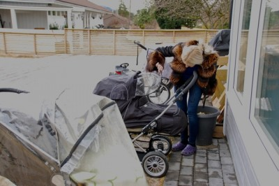 A woman checks on a baby napping outdoors at a day care center in Bergen on Wednesday. The practice is widespread throughout the country, but now it's being questioned. PHOTO: newsinenglish.no