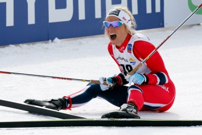 Norwegian skier Therese Johaug collapsed in screams at the finish line after winning the women's 10-kilometer race where they can choose their techniques. PHOTO: FIS Nordic World Ski Championships/fiemme2013/Newspower Canon