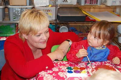 """Education Minister Kristin Halvorsen, shown here visiting a Norwegian day care center,  has been a strong proponent of such centers in Norway and they've been high on the agenda of her party, the Socialist Left, for years. Now she agrees that inspections of the """"barnehager"""" should not be conducted by the local governments running them, but by more independent county authorities. PHOTO: Kunnskapsdepartementet"""