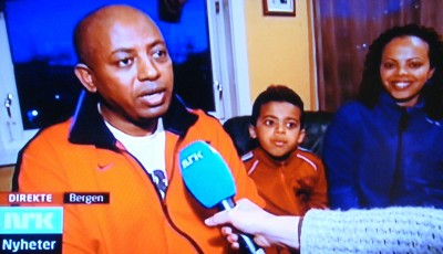 Seven-year-old Nathan Eshete has become a celebrity of sorts in Norway over his family's battle to remain in Norway even though his parents' application for asylum was rejected. Here, Norwegian Broadcasting (NRK) interviewed Nathan's father Asfaw Eshete after their court victory against immigration authorities on Tuesday. At right, Nathan's relieved mother Zinash Assefa. PHOTO; NRK screen grab/newsinenglish.no