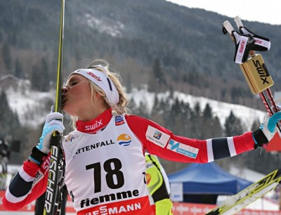 Norwegians don't make a habit of kissing their skis, like Therese Johaug did here after winning more World Championship gold, but many do love the sport. PHOTO: FIS Nordic World Ski Championships/Newspower Canon