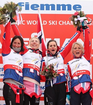 Heidi Weng, second from right, was the heroine of the women's relay after she skied fast and efficiently in the first lap and helped assure another gold medal for Norway at the world championships. From left on the winners' platform: Marit Bjørgen, Kristin Størmer Steira, Weng and Therese Johaug. PHOTO: FIS Nordic World Ski Championships/fiemme2013/Newspower Canon