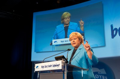 """Erna Solberg making a point during her party's national meeting during the weekend. The party slogan on the podium reads """"New ideas, better solutions."""" PHOTO: Høyre/Tomas Moss"""