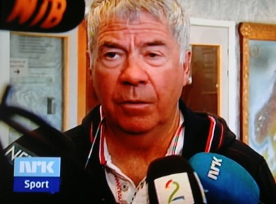 """National football coach Egil """"Drillo"""" Olsen, surrounded by reporters on Monday after news broke that John Arne Riise would no longer play for Drillo's team. PHOTO: NRK screen grab/newsinenglish.no"""