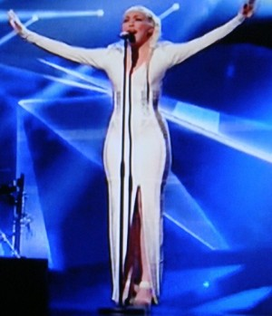 "Margaret Berger's form-fitting dress has generated lots of comments but it seemed almost modest compared to the one worn by the singer from Israel, Moran Mazor. It gave new meaning to the term ""low cut."" PHOTO: NRK screen grab/newsinenglish.no"