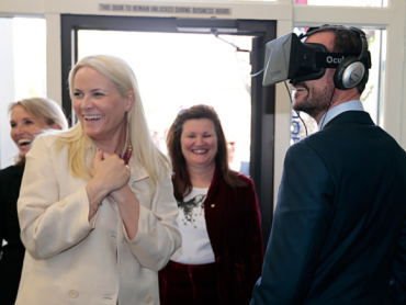 Crown Princess Mette-Marit laughs as her husband tries on a 360-degree video technology device at Innovation House in Palo Alto, California. PHOTO: kongehuset.no