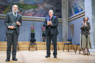 King Harald applauds Pierre Deligne after presenting him with this year's prestigious Abel Prize in mathematics. The ceremony was held in the Aula of the University of Oslo, famous for its murals by Norwegian artist Edvard Munch. PHOTO: Abel Prize