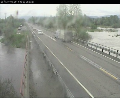This rain-splashed web camera from the state highway department showed a portion of the E6 highway through Hamar still above water Thursday morning, but it's closed in several spots farther north. PHOTO: Statens Vegvesen
