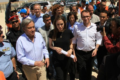 Norwegian Foreign Minister Espen Barth Eide (right, in white shirt) was in Jordan with UN representatives including actress Angelina Jolie (center) to plead the cause of refugees. Just a week earlier, Eide's own government had deported a family whose children had grown up in Norway to, ironically enough, Jordan, and protests have continued over how Norway treated them. PHOTO: Utenriksdepartementet
