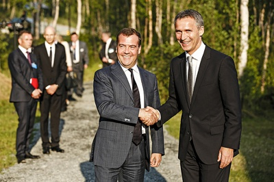 "Norwegian Prime Minister Jens Stoltenberg (right) and Russian Prime Minister Dmitry Medvedev are said to have generally good relations, The sunny weather they enjoyed when meeting on Monday turned into rain and wind on Tuesday, but they continued bilateral talks after the Barents Summit with a planned boat ride on a research vessel, review of search and rescue operations and then a ""working lunch"" and wreath-laying at the Russian War Memorial outside Kirkenes. Their meeting was to end at the Russian-Norwegian border crossing late Tuesday afternoon. PHOTO: Utenriksdepartementet"
