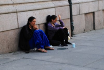 These beggars just outside the Parliament in Oslo face new restrictions approved by Norwegian politicians inside the Parliament. PHOTO: newsinenglish.no