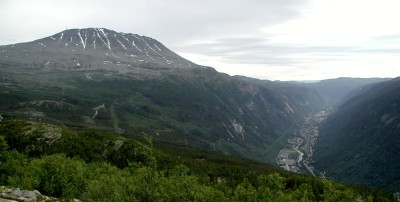 Rjukan, seen at far right in this photo, is located at the bottom of a valley in the mountains of Telemark. That's why it doesn't get any sun in the winter, but it may now. At right, the peak known as Gaustatoppen. PHOTO: Wikipedia Commons