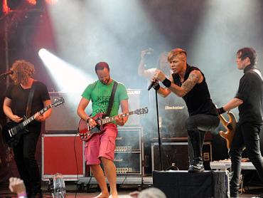 Crown Prince Haakon (in shorts) performing onstage with the Norwegian band Seigmen. PHOTO: Sven Gjeruldsen/Det kongelige hoff