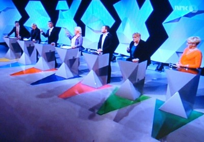 No, it's not a large Kraftverk concert, rather all the leaders of Norway's seven largest political parties gathered for their first major debate of the election campaign on Monday night. Their constant maneuvering for government power has all but clouded the actual issues at hand, and voters can't be sure which parties will eventually form a government. PHOTO: newsinenglish.no/NRK screen grab