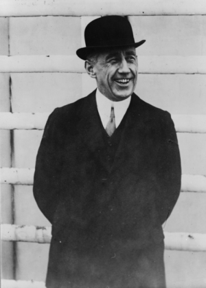 Roald Amundsen in a rare photo from 1913 where he's shown smiling. He otherwise posed with serious, even stern, expressions. PHOTO: Wikipedia Commons