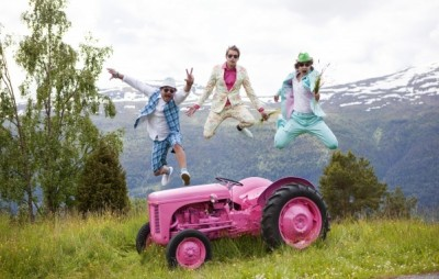 """Moods of Norway founders Simen Staalnacke, Peder Børresen and Stefan Dahlkvist, seem to be jumping with joy near their trademark shocking pink tractor. The company's website notes that the its main goal """"besides making our grandmas happy, is to make happy clothes for happy people around the world."""" PHOTO: moodsofnorway.com"""