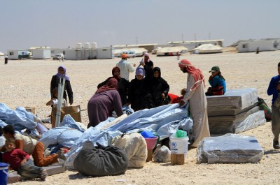 Residents sort out some of their belongings at the Zatari refugee camp for Syrians in Jordan. Norway has offered to take in 1,000 Syrian refugees, including 300 now in Jordan, 300 in Lebanon and 400 in Turkey. Sweden, by comparison, has already taken in 16,000 Syrian regufees. PHOTO: Utenriksdepartementet/Frode Overland