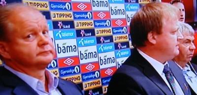 "Per-Mathias Høgmo (left), new head coach for the national men's football, listens as his predecessor Egil ""Drillo"" Olsen was effectively fired by football president Yngvar Hallén (center). PHOTO: NRK screen grab/newsinenglish.no"