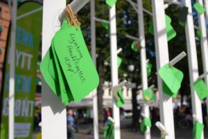 The party's stand features green tags with campaign platform measures aimed at promoting sustainability. This one promotes high-speed trains over airline traffic. PHOTO: newsinenglish.no