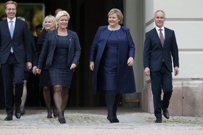 Erna Solberg (second from right) shown striding out of the Royal Palace as Norway's new prime minister in October. On her right is the new finance minister, Siv Jensen, with the new foreign minister Børge Brende at far left and the minister in charge of municipal governments, Jan Tore Sanner, at far right. PHOTO: Statsministerenskontor