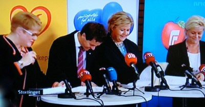 The four leaders of Norway's non-socialist parties couldn't agree on a coalition government platform but at least signed a political agreement aimed at securing non-socialist rule through the next four-year parliamentary period. From left: Trine Skei Grande of the Liberal Party (Venstre), Knut Arild Hareide of the Christian Democrats (Kristelig Folkeparti, KrF), Erna Solberg of the Conservatives (Høyre) and Siv Jensen of the Progress Party (Fremskrittspartiet, Frp). PHOTO: NRK screen grab/newsinenglish.no