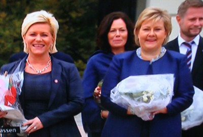 Prime Minister Erna Solberg (right) and Finance Minister Siv Jensen are just two of the women holding powerful positions in Norway. The country also has female defense and trade ministers, but not a single female CEO among the major companies trading on the Oslo Stock Exchange. In the background, Norway's government minister in charge of family issues, Solveig Horne, with Health Minister Bent Høie. PHOTO: NRK screen grab/newsinenglish.no