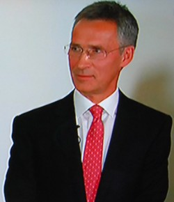 Former Prime Minister Jens Stoltenberg, listening to unusual compliments from his political rival and successor, Erna Solberg. PHOTO: NRK screen grab/newsinenglish.no