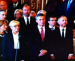 Prime Minister Jens Stoltenberg's outgoing government, standing at attention while King Harald V read their declaration for the year ahead. Since they're due to resign next week, some of their declarations are moot, others may be carried out. PHOTO: NRK screen grab/newsinenglish.no