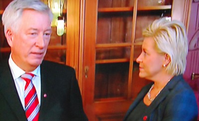 New Finance Minister Siv Jensen listens to some words of wisdom from her predecessor Sigbjørn Johnsen as she took over his office on Wednesday. State broadcaster NRK carried several of the takeover ceremonies live on national TV. PHOTO: NRK screen grab/newsinenglish.no