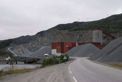 """The Kvalsund mine along the Repparfjord is below the mountains where Nussir, also known as The Norwegian Copper Company, has struck mineral veins containing copper. Many object to Nussir's plan to use the fjord for """"temporary storage"""" of its tailings, but the company denies it will be dumping debris. PHOTO: newsinenglish.no"""