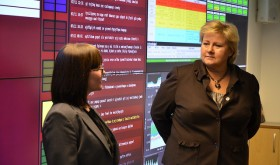 Prime Minister Erna Solberg, shown here on a visit to Norway's national security authority NSM, has claimed she's careful when using her mobile (cell) phone. She also has criticized alleged spying among NATO allies. PHOTO: Statsministerens kontor