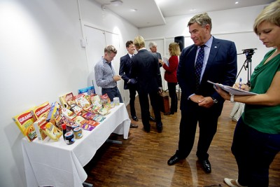 Orkla Chairman Stein Erik Hagen, who long has ranked as one of Norway's wealthiest citizens, gazes at some of his company's food products when it took over another food producer, Rieber & Søn. Hagen has been known for championing tax cuts and deregulation, but now his food products company is sending a very different message. PHOTO: Orkla/NTB Scanpix