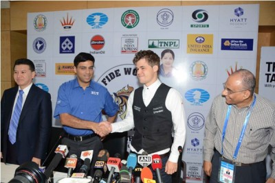 Magnus Carlsen met his opponent, Vishy Anand, on Anand's home turf in Chennai on Thursday. Their battle for the Chess World Championship begins on Saturday. PHOTO: FWCM2013/FIDE Chess World Championship