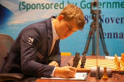 Magnus Carlsen, playing black, won again in the Chennai world championship on Saturday.  PHOTO: Paul Truong