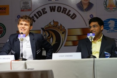 Magnus Carlsen (left) was smiling after Wednesday's battle over the chessboard against Vishy Anand. PHOTO: Paul Truong