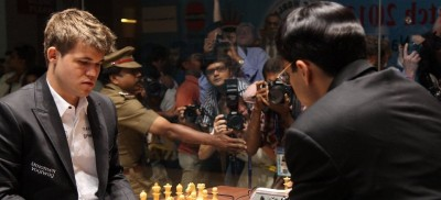 Magnus Carlsen faced defending world championVishy Anand for a third time on Tuesday, but the game ended in another draw. PHOTO: Chennai2013/FIDE