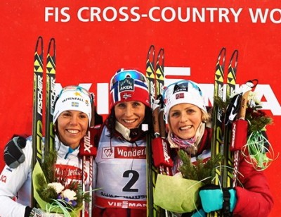 Norway's undisputed ski queen Marit Bjørgen (center) clinched her first World Cup victory of the season at the opening competition in Finland over the weekend. At left, silver medal winner Charlotte Kalla of Sweden and at right, Norwegian teammate Therese Johaug. PHOTO: Ruka Nordic Opening 2013/Patrick Forsblom
