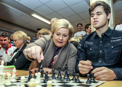 The Norwegian Prime Minister, Erna Solberg tests her mettle against 23-year-old chess world champion Magnus Carlsen last month. Solberg was amongst those congratulating Carlsen after the annual Sports Gala on Saturday night. Carlsen won three major prizes, but was controversially not eligible for athlete of the year. PHOTO: Statsministerens kontor/Stein J Bjørge