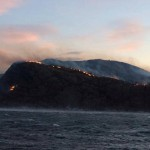 """This photo taken aboard the rescue vessel """"Harald V"""" shows how the brush fire spread over hillsides on the coastal peninsula in Nord-Trøndelag, where an estimated 140 buildings were estimated to have been destroyed by midday on Tuesday. PHOTO: Redningsskøyta Harald V"""