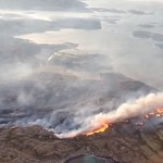 The fire front stretches the peninsula, razing the small coastal communities in its path. About 90 homes and buildings were destroyed on Tuesday, but all residents escaped unharmed. PHOTO: Forsvaret
